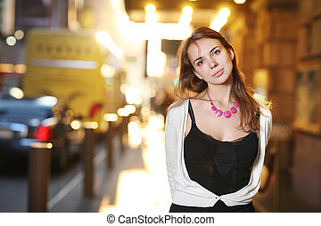 Beautiful young woman on sunny street - Portrait of a...