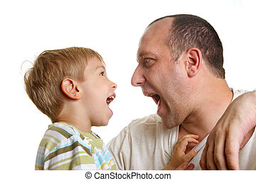 Little son playing with father