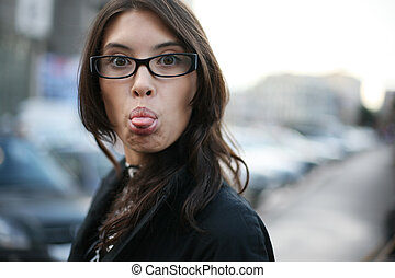 Young businesswoman woman sticking out her tongue - Young...