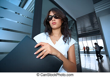 Bautiful young businesswoman in futuristic interior