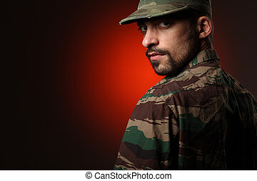 Tough soldier - Portrait of a tough soldier looking at...