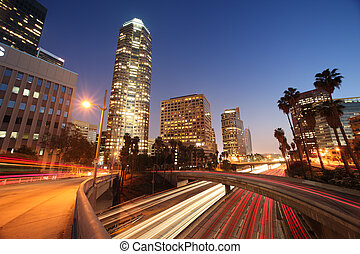 Freeway traffic in downtown Los Angeles at twilight
