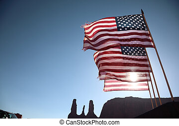 American flags - Four American flags waving over blue sky