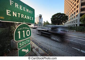 Car entering freeway - 110 South Freeway entrance. Downtown...