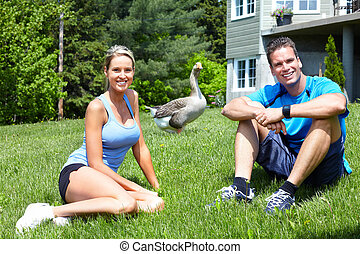 Sportive people - Young couple relaxing in park Healty...