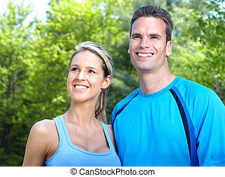 Sportive people. - Young couple relaxing in park. Healty...