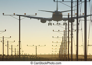 Plane over runway - Plane landing over runway in airport at...