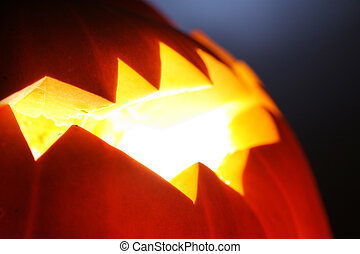 Halloween background - Glowing Jack-O-Lantern detail,...