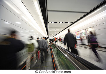 People walking, blurred motion - Dynamic photo of busy crowd...