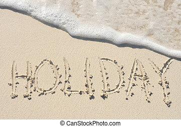 Hoilday Written in Sand on Beach