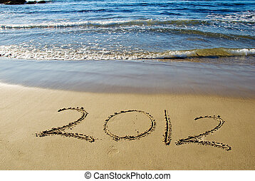 2012 happy new year - 2012 new year written in sand on the...
