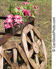 Village landscape with wooden wheels from an ancient cart