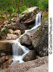 waterfall in summer woods - waterfall among rocks in summer...
