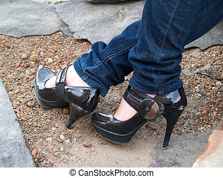 High-heeled shoes - Leg girl in jeans and high-heeled shoes...