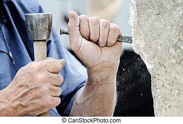 stone sculptor - a stone carver at work