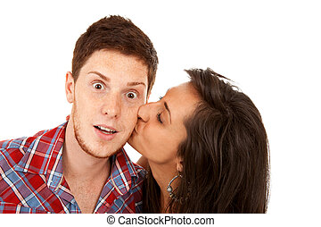 woman kisses her boyfriend on the cheek - pretty young woman...
