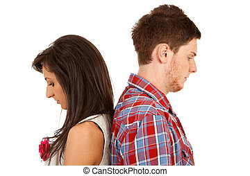 relationship difficulties - Young couple standing back to...