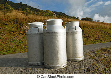 Mountain milk - Milk cans ready for collection the evening,...