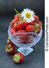 Antique glass vase with strawberrie