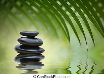 Zen stones - Grean bamboo leaves over zen stones pyramid...