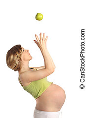 Pregnant woman with apple
