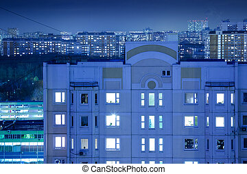 Night buildings background - Generic buildings with brightly...