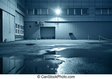 Industrial building detail - Dark industrial building at...