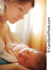 Newborn baby with mother - Mother with sleeping newborn baby...