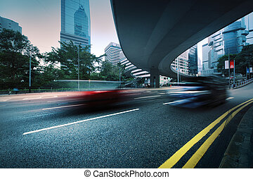 Blurred motion - Long exposure photo of cars driving on...
