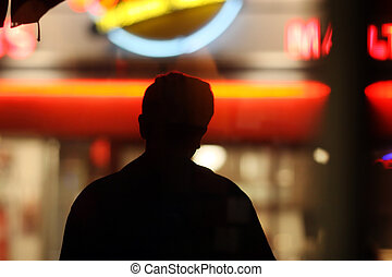 Silhouette over neon lights - Black male silhouette over...