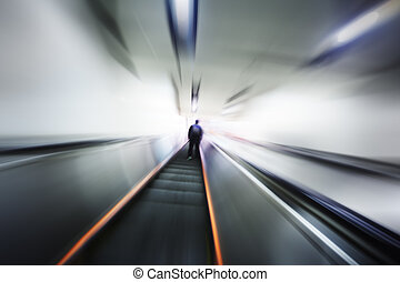 Abstract blurred motion interior - Lonely person moving up...