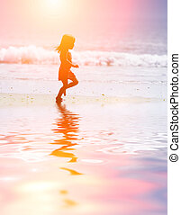 Child running at beach - Child running on water at ocean...