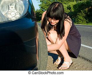 woman repairing the car