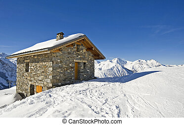 Small mountain hut on a ski slope with a view of the...