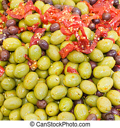 olives in pickle - appetizer of olives in pickle with tomato...