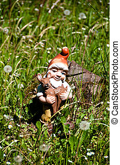 Garden Dwarf - Old plastic garden dwarf gnome carrying a...