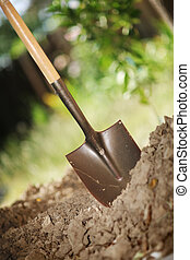 Digging soil - Digging spring soil with shovel. Close-up,...