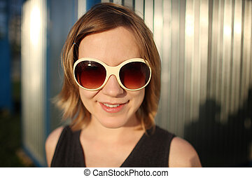 Happy girl in sunglasses - Portrait of happy young woman in...