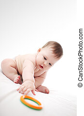 Baby with toy - Cute baby girl reaching out for toy on white...