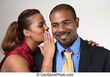 Woman wispering in husband's ear - Woman whispering in...