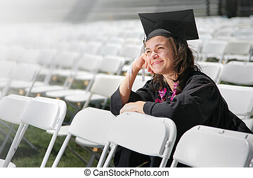 Dreaming graduate - Happy graduate daydreaming Closeup,...