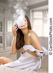 woman smokes a cigaret - woman in prom dress smokes cigaret...