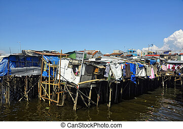 Stilt Houses - Shanties of illegal settlers on stilts in...