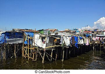 Stilt Houses - Shanties of illegal settlers on stilts in...