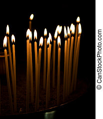 Burning candles - Burning votive candles in a Greek church...