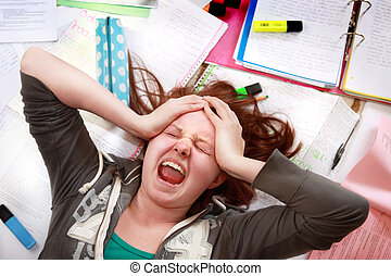 Teenage exam stress - Teenage girl cracking under the...