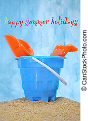 happy summer holidays - a castle bucket with shovels and...