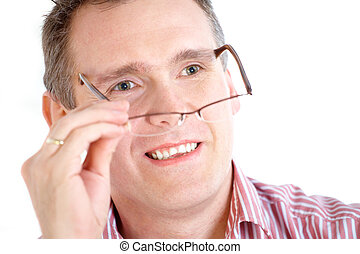 Man taking off glasses - Close up of male face, taking off...