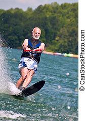 Senior waterskier - Baby boomer waterskis.