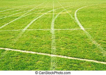 Grass race track with running lanes marked